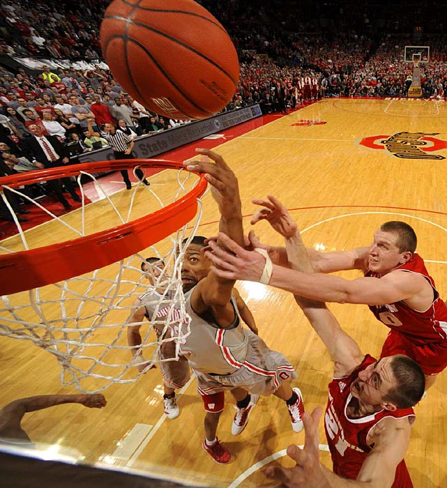 Ohio State's Lenzelle Smith, Jr. (32) battles for a rebound with Wisconsin's Jared Berggren (40) and Josh Gasser (21) in the Badgers' comeback win at the Buckeyes on Sunday.