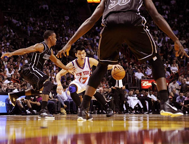 Knicks point guard Jeremy Lin attempts to drive against the Heat's Norris Cole. Miami drove Lin insane in their comfortable win over the Knicks, holding the overnight sensation to eight points on 1-11 shooting with eight turnovers.