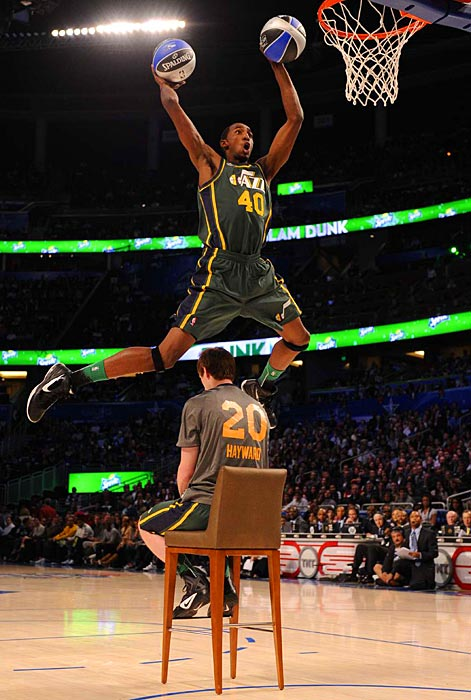 Utah Jazz forward Jeremy Evans leaps over teammate Gordon Hayward as he prepares to dunk two balls simultaneously. Evans, who was only invited to the contest because Knicks guard Iman Shumpert pulled out, beat out three other players for the slam dunk crown.