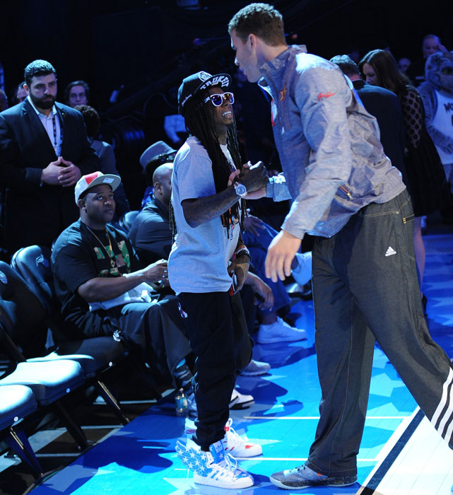 Clippers forward Blake Griffin shows Weezy some love at the 2012 All-Star game.