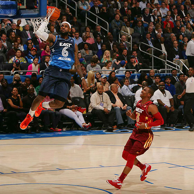 LeBron James dunks as Chris Paul watches, a pair of actions not foreign to the All-Star Game.