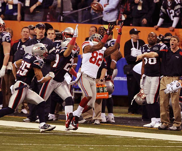 Manningham made the catch of the game, pulling in this one to keep the Giants game-winning drive going.