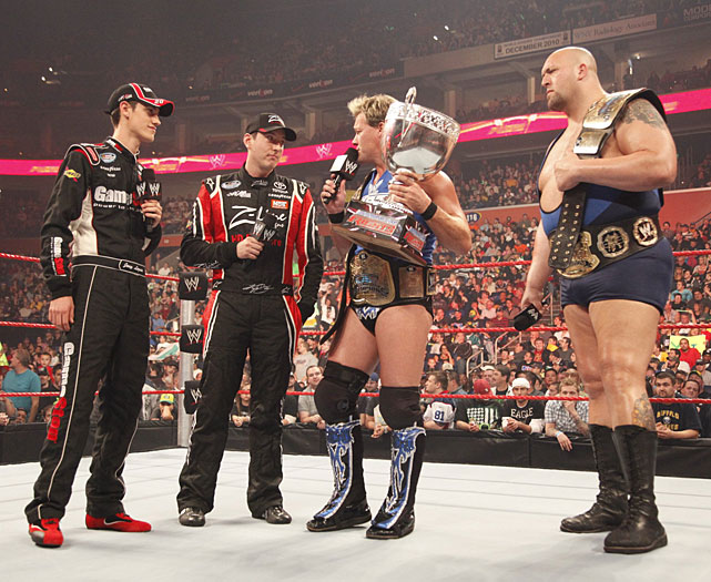 NASCAR drivers Joey Logano and Kyle Busch confront tag team champions Chris Jericho and The Big Show during a Oct. 2009 episode of Monday Night Raw. The two drivers were guest-hosting the show.