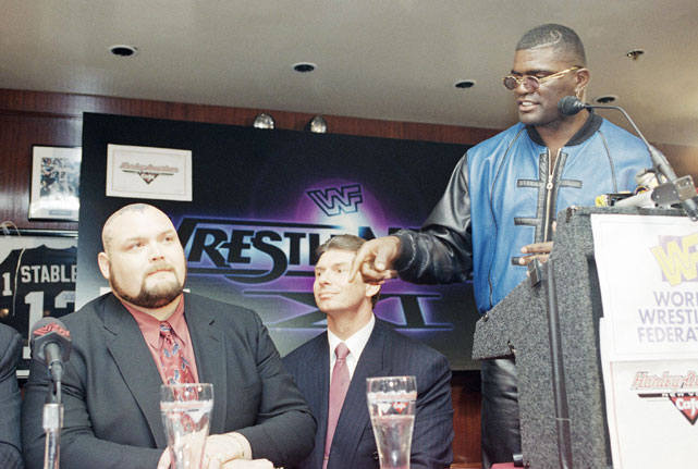 Former Giants linebacker Lawrence Taylor gestures while addressing professional wrestler Bam Bam Bigelow and WWE CEO Vince McMahon during a Feb. 1995 press conference. LT defeated the 390-pound Bigelow in the main event of WrestleMania XI.