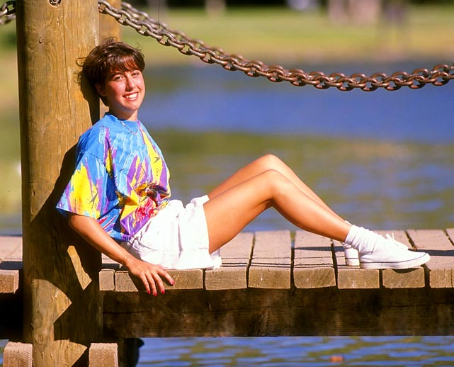 Evans poses for a picture in 1990. She nabbed seven world records throughout her career, setting her first mark at 15.