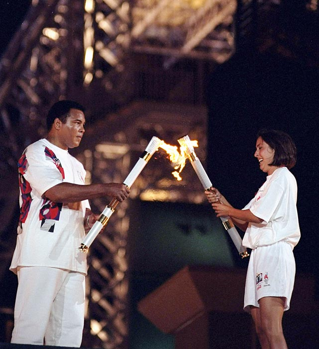 Evans passes the torch to Muhammad Ali at the opening ceremony of the 1996 Atlanta Olympics.