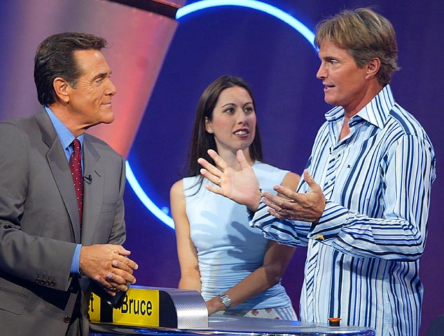 "Evans and Olympian Bruce Jenner (right) talk with game show host Chuck Woolery on the set of ""Lingo"" in October 2003."