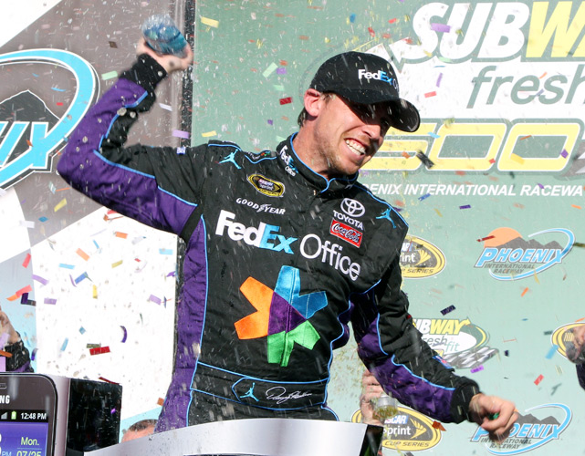 In just his second race under new crew chief Darian Grubb, Denny Hamlin held off Kevin Harvick to take the checkered flag at Phoenix. Hamlin's 18th career victory came at the site of his 2010 collapse, where his title hopes were dashed due to poor fuel strategy. This time, Harvick was the one who ran out of gas, clearing the way for Hamlin's win.