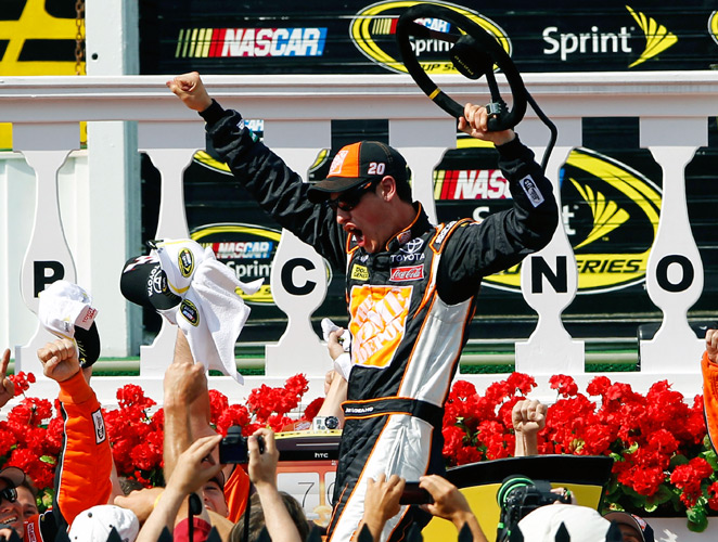 Joey Logano slipped under Mark Martin in the closing laps to take the checkered flag at Pocono for his first victory since 2009. The win also marked the first time in 31 races a Sprint Cup driver had won from the pole position.