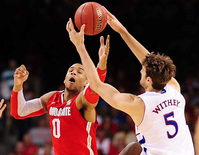 Ohio State's Jared Sullinger (0) battles for possession with Jeff Withey (5) of Kansas. Sullinger managed a double-double against Withey and the Jayhawks' post pressure.