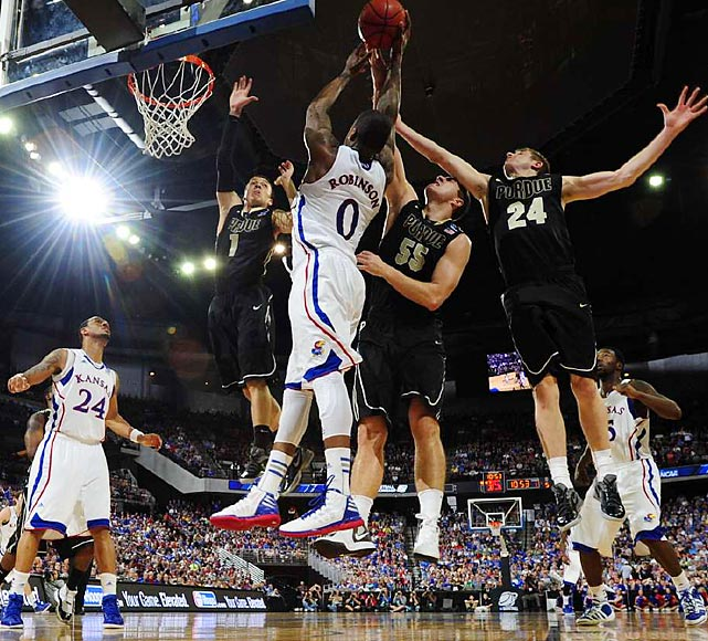 Kansas held off Robbie Hummel and the Boilermakers in a heated third-round matchup. Jayhawks big man Thomas Robinson scored 11 points and grabbed 13 rebounds en route to the 63-60 win.