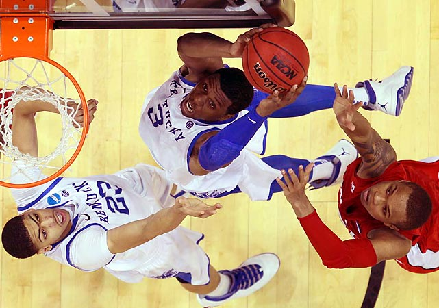 Kentucky began its quest for an eighth national title with a commanding win over No. 16 seeded Western Kentucky. Wildcats' freshman Anthony Davis (23) had 16 points, nine rebounds and seven blocks en route to the 81-66 win.