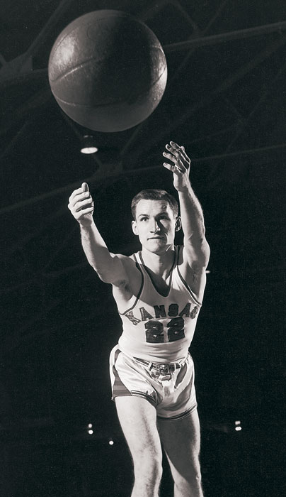 "Kansas doesn't just produce great players -- they churn out more than their fair share of coaches, too. Here, legendary North Carolina coach Dean Smith is shown in his Jayhawks jersey. Other notable coaches with Kansas ties include Roy Williams, Bill Self, Larry Brown, Adolph Rupp and ""The Father of Basketball Coaching,"" Phog Allen."