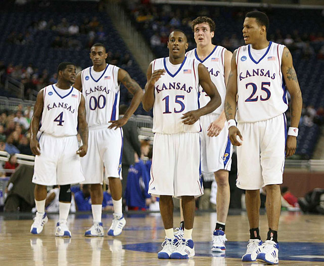 Sherron Collins (4), Darrell Arthur (00), Mario Chalmers (15), Sasha Kaun (24) and Brandon Rush (25) walk onto the floor during a 2008 NCAA Tournament game against Villanova. The Jayhawks would go on to beat Memphis in the national championship game for the school's third NCAA title.