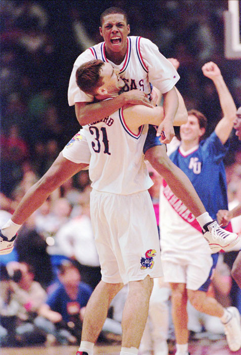 Paul Pierce (34) leaps into the arms of Scot Pollard (31) after Kansas beat Arizona 83-80 to advance to the 1996 Elite Eight. Pierce is one of many current- and former-NBA stars who attended Kansas.