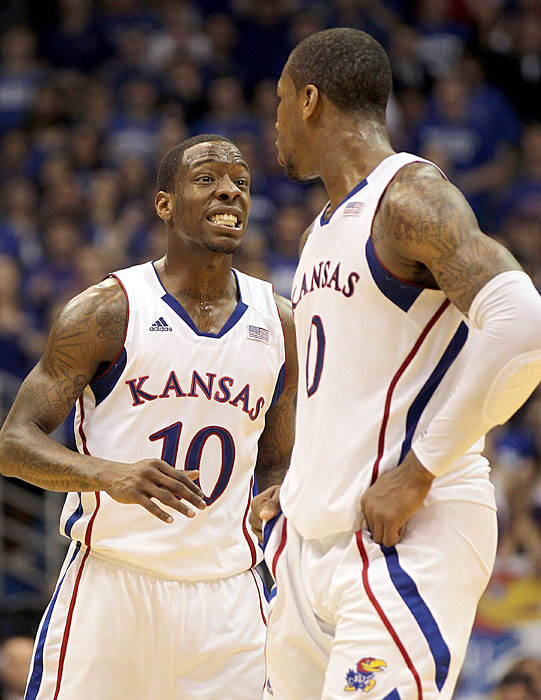 Tyshawn Taylor (10) reacts with Thomas Robinson (0) as their Feb. 25 game against longtime rivals Missouri goes into overtime. Kansas overcame a 19-point second half deficit before beating the Tigers in OT. Robinson, Taylor and their Jayhawks teammates are expected to be a No. 1 seed in this year's NCAA tournament.