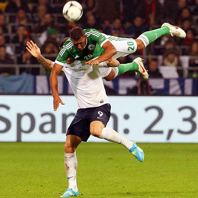 Germany's Jerome Boateng climbs over the back of France's Olivier Giroud during a friendly match last week.