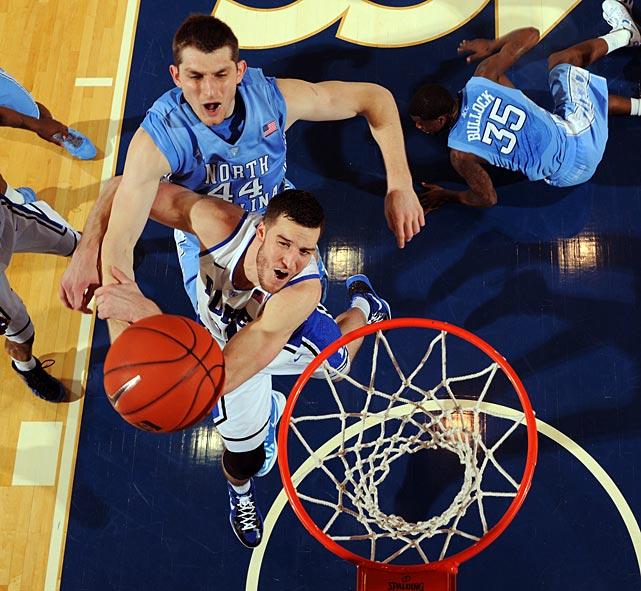 Duke center Miles Plumlee battles for a rebound with North Carolina big man Tyler Zeller at Cameron Indoor Stadium on Saturday.