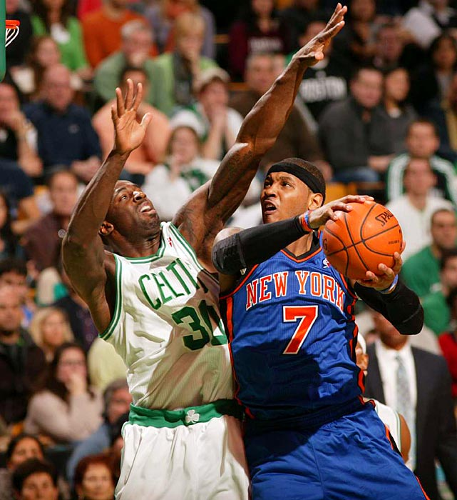 The Knicks' Carmelo Anthony takes it to the hoop against Boston's Brandon Bass in the Celtics' overtime win on Sunday.