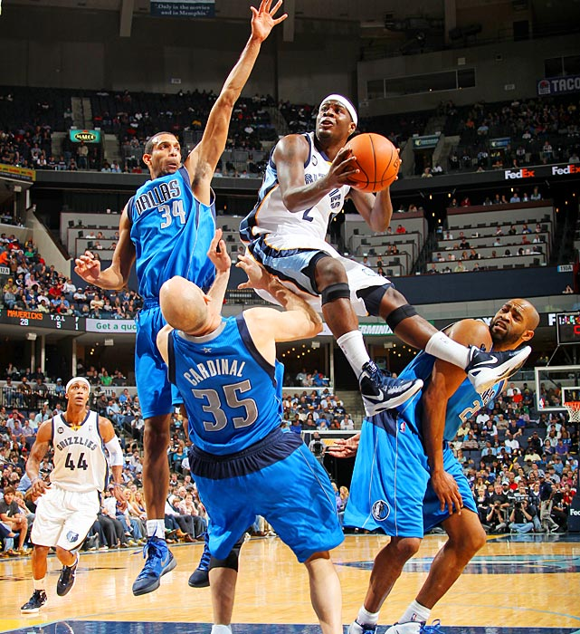 Memphis guard Josh Selby gets way up as he attempts a shot against the Mavericks' Brian Cardinal (35) and Brandan Wright (left). Vince Carter's just trying to get out of the way.