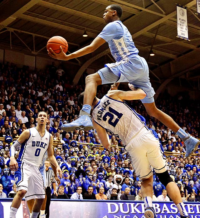 UNC's John Henson leaps over Duke's Miles Plumlee in the Tar Heels' resounding road win over their bitter Tobacco Road rivals.