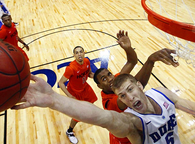Duke forward Mason Plumlee reaches for a rebound in an ACC tournament game against Virginia Tech.