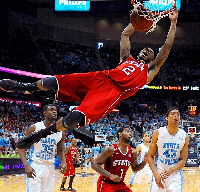 North Carolina State guard Lorenzo Brown slams a ball home as several of his teammates and University of North Carolina players look on during the ACC Tournament semifinals.
