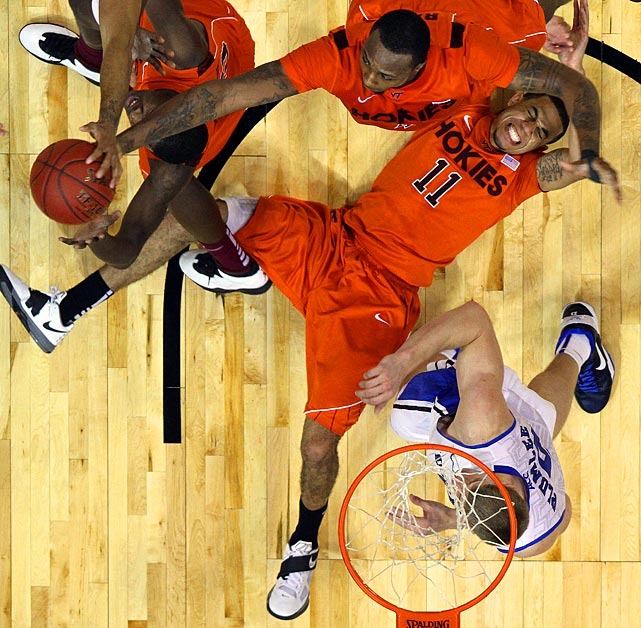 Virginia Tech guard Erick Green (11) falls to the floor as others vie for a rebound during the second half of a ACC Tournament quarterfinals game.