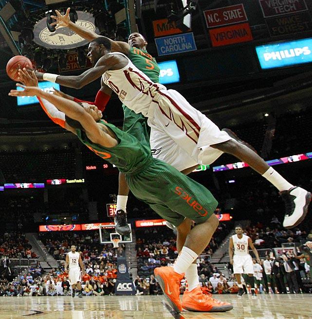 Florida State forward Okaro White shoots around a pair of Miami defenders in the ACC Tournament quarterfinals in Atlanta.