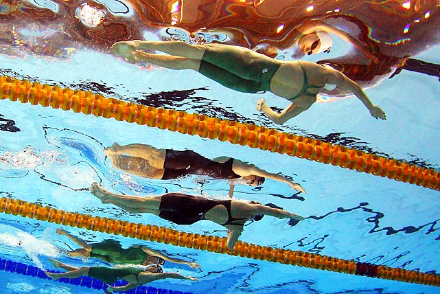 Meagen Nay, Emily Seebohm and Belinda Hocking race in the 100 meter backstroke final during the Australian swimming Olympic Trials.