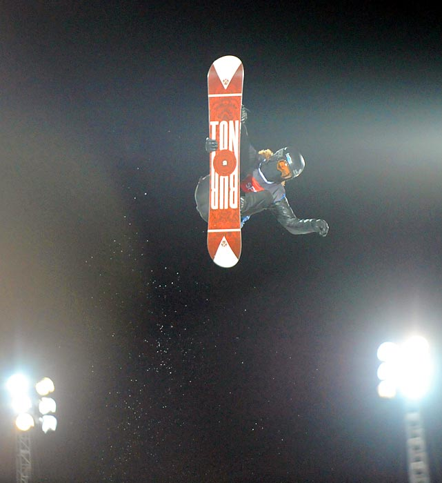 Shaun White flies through the air during the Snowboard Superpipe eliminations, part of the European Winter X-Games.