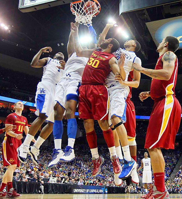 Iowa State's Royce White fights for the ball against three Kentucky players in a third round game of the NCAA tournament.