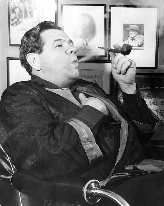 Ruth relaxes by smoking a pipe.