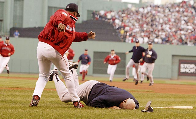 Yankees bench coach Don Zimmer is thrown to the ground by Red Sox starting pitcher Pedro Martinez during an altercation in the fourth inning of Game 3 of the 2003 American League Championship Series. Both benches emptied after Red Sox batter Manny Ramirez complained about an inside pitch by Yankees starter Roger Clemens.