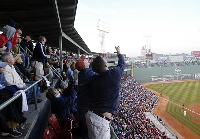 Red Sox fans reach for a foul ball during a 2003 game against the Yankees.