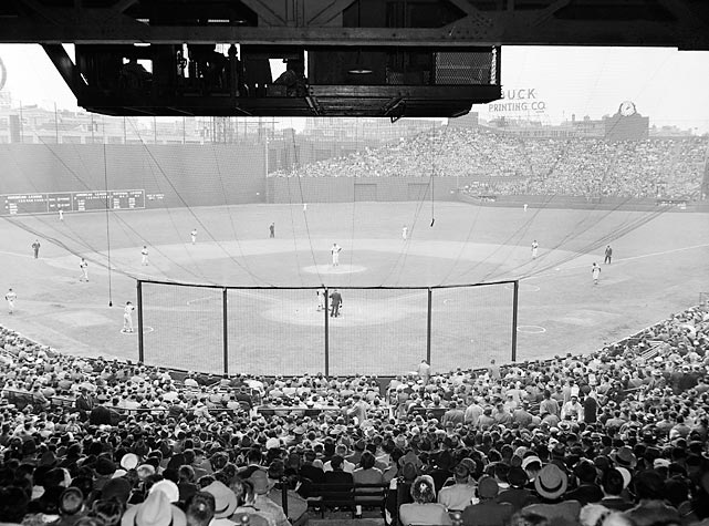 A view from behind home plate of the 1956 season opener between the Red Sox and Orioles.