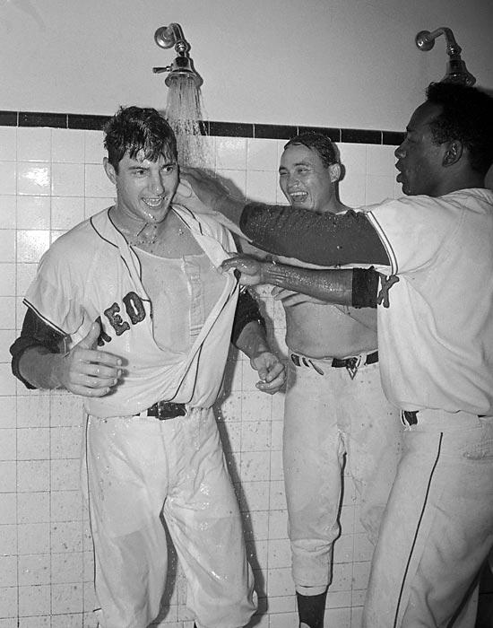 Carl Yastrzemski, Jose Santiago and Jose Tartabull celebrate after beating Minnesota to advance to the World Series.