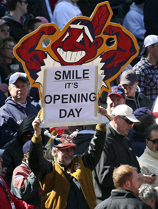 A Cleveland Indians fan holds up a sign celebrating opening day before their home opening MLB American League baseball game against the Toronto Blue Jays in Cleveland, Ohio April 5, 2012.