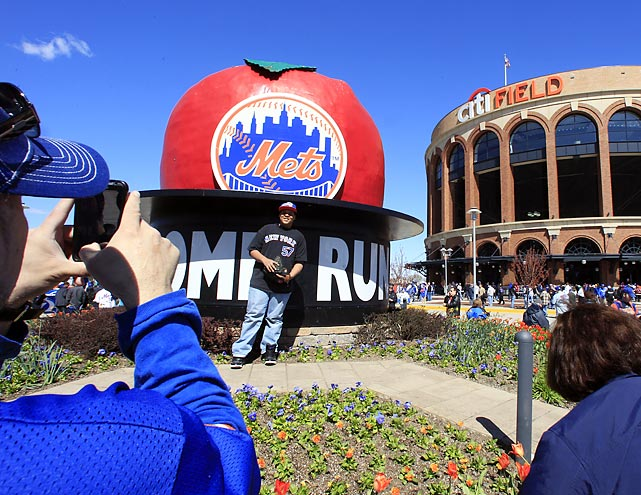 Fans pose  before the season opening game at Citi Field between the New York Mets and the Atlanta Braves.