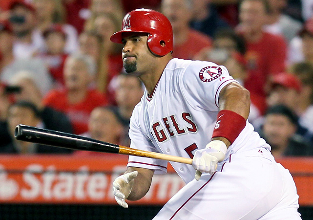 Albert Pujols made his regular-season debut for the Angels and finished 0-for-3 with a walk. Jered Weaver struck out 10 in eight innings and Los Angeles used a five-run eighth inning to beat the Royals 5-0.
