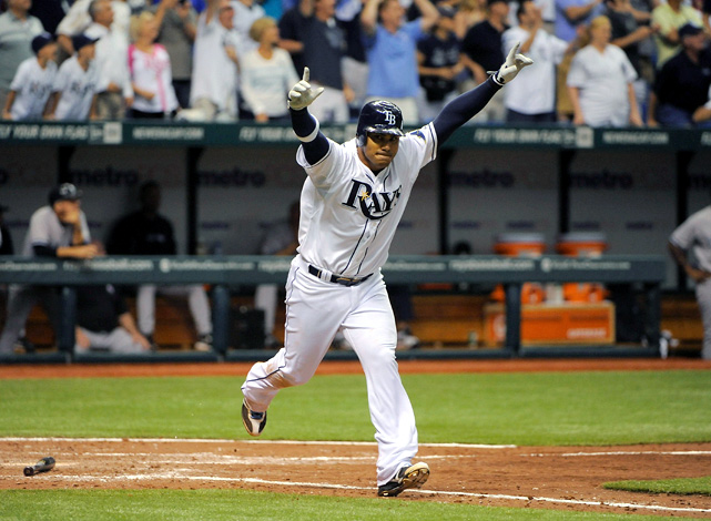 Carlos Pena thrust his arms in the air, rounded first base and headed right into a wild celebration in the middle of the Tropicana Field infield. Pena hit a first-inning grand slam off CC Sabathia and delivered an RBI single off Mariano Rivera in the ninth, lifting the Rays to a thrilling 7-6 season-opening victory over the Yankees.