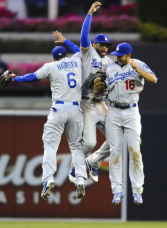 Los Angeles Dodgers Jerry Hairston Jr. (6), Matt Kemp (center) and Andre Ethier (16) celebrate following a 5-3 opening-day win over the San Diego Padres at Petco Park.