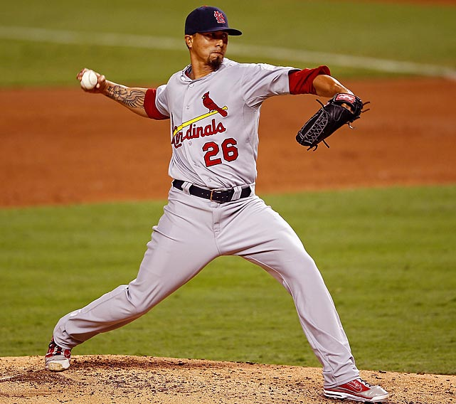 Kyle Lohse held Miami hitless until the seventh inning and pitched into the eighth to help the St. Louis Cardinals win the first game in Marlins Park, 4-1 Wednesday night.
