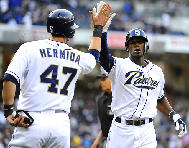 Padres center fielder Cameron Maybin is congratulated by Jeremy Hermida after his two-run homer in the eighth inning against the Dodgers. San Diego lost 5-3 in its home opener to Los Angeles.