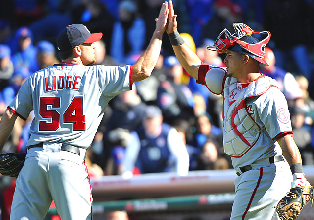 Nationals closer Brad Lidge is congratulated by catcher Wilson Ramos after Washington rallied for a 2-1 victory against the Cubs on opening day at Wrigley Field.