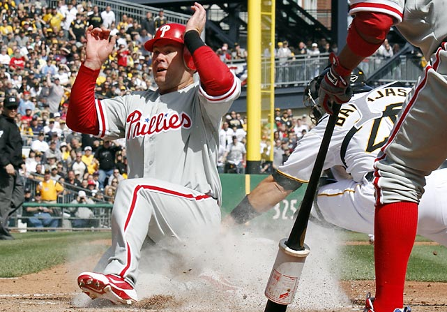 In the first of what will probably turn out to be very many 1-0 games for the Phillies, Ty Wigginton scored their only run by sliding home safely on a shallow sacrifice fly by Carlos Ruiz to right.