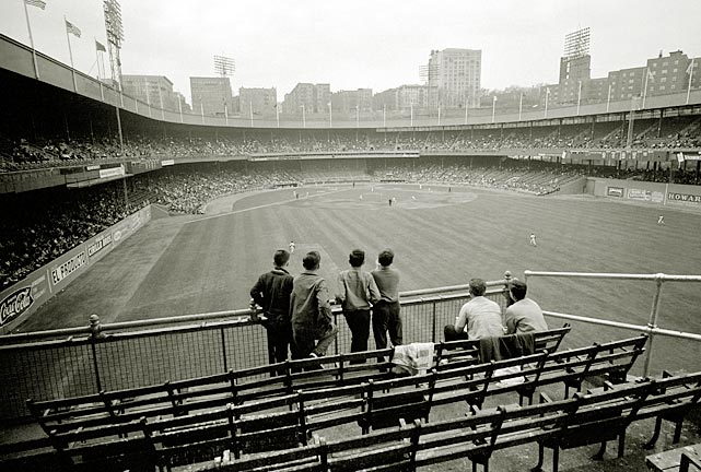 Fans in the right field bleachers watch the Mets take on the Milwaukee Braves in this 1963 photo.