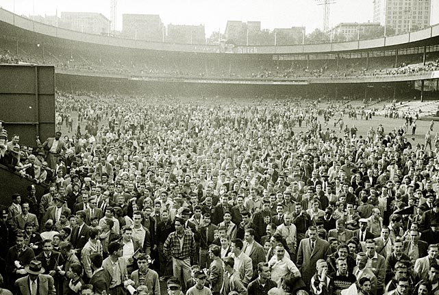 Fans pack the field after the Giants' final game at the Polo Grounds. Team owner Horace Stoneham announced his decision to move the team to San Francisco in the summer of 1957.
