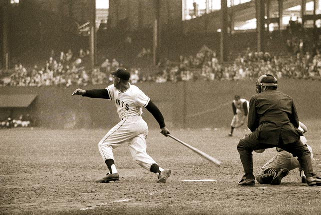 Willie Mays finishes his swing in this 1957 photo.