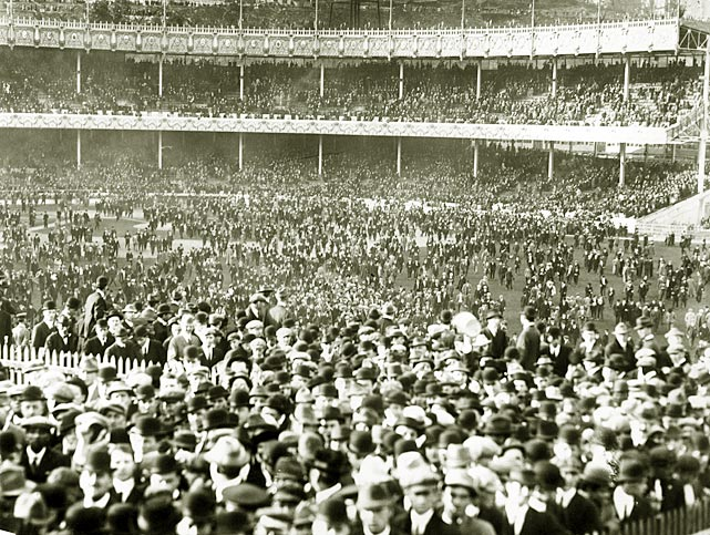 Fans rush the field after a 1915 game at the Polo Grounds.